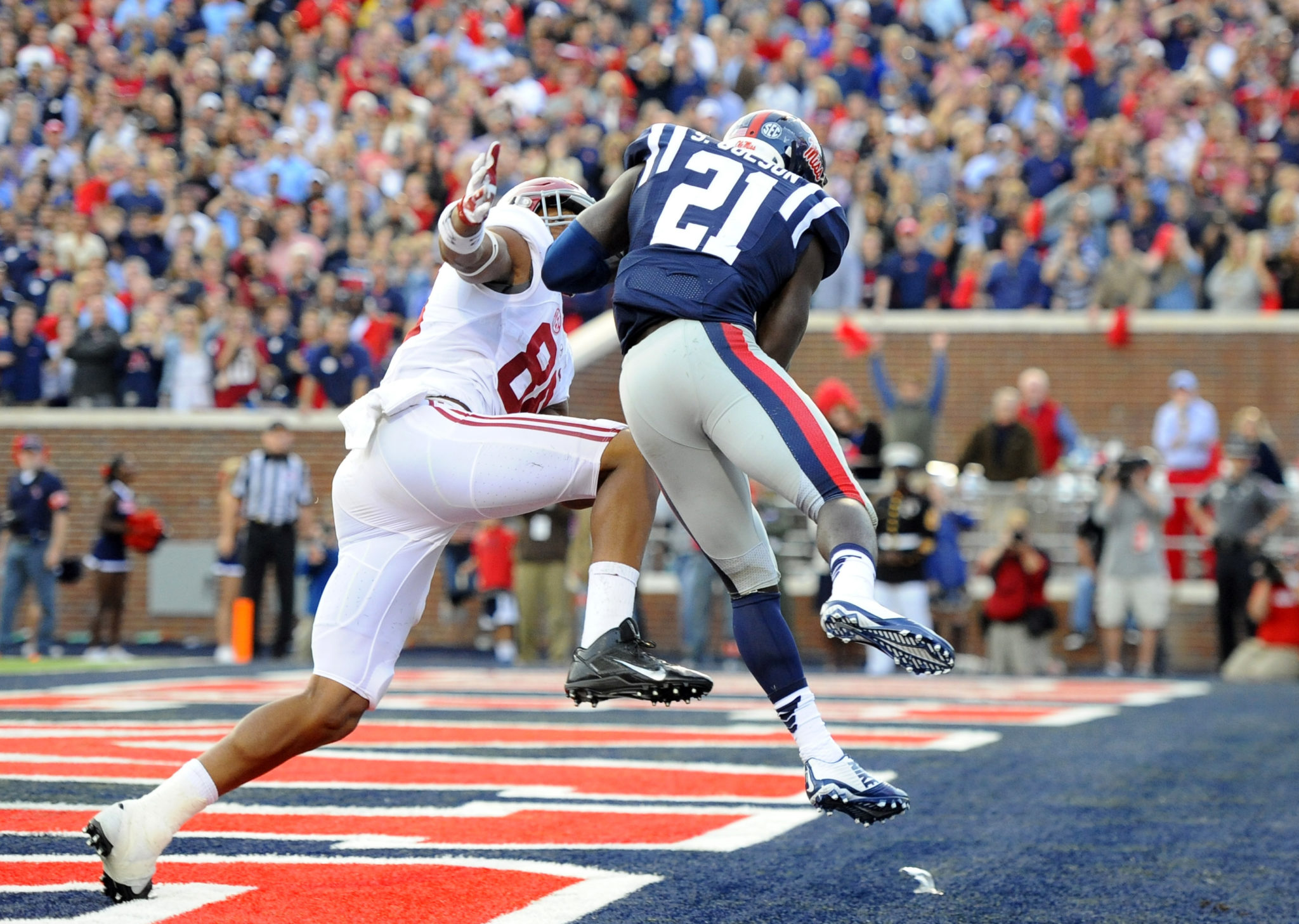 Oct 4, 2014; Oxford, MS, USA; Mississippi Rebels defensive back Senquez Golson (21) intercepts a pass in the end zone intended for Alabama Crimson Tide tight end O.J. Howard (88) to win the game during the second half at Vaught-Hemingway Stadium. The Rebels won 23-17. Mandatory Credit: Christopher Hanewinckel-USA TODAY Sports