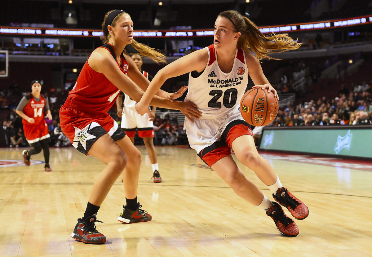 Mar 30, 2016; Chicago, IL, USA;  McDonalds High School All-American West player Sabrina Ionescu (20) dribbles the ball against McDonalds High School All-American East player Lindsey Corsaro (4) during the second half at the United Center. Mandatory Credit: Mike DiNovo-USA TODAY Sports ORG XMIT: USATSI-267704 ORIG FILE ID:  20160330_ajw_ad4_027.jpg